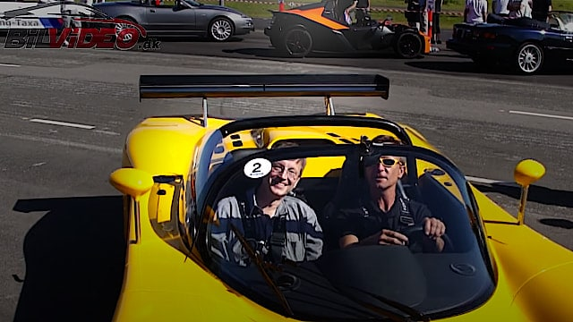 Ultima Can Am Convertible against a Lamborghini Mucielago Lp 640